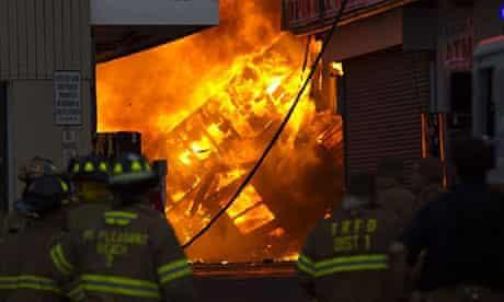 Firefighters tackle the huge blaze in Seaside Park, New Jersey.