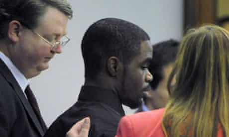 De'Marquise Elkins stands with his lawyers as he is sentenced.