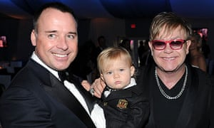 Elton John with his partner David Furnish and their son Zachary, 2012.