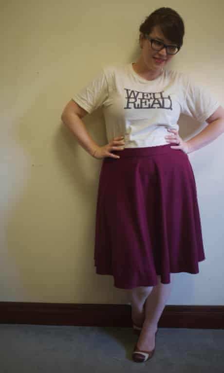 "Lilli wearing a t-shirt printed with the slogan ""well read"", and a maroon skirt"