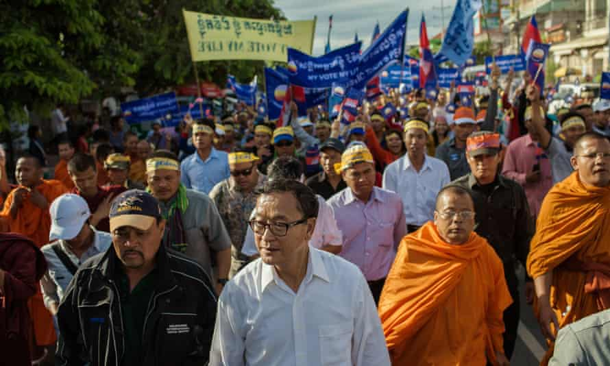 Thousands of Cambodian National Rescue Party supporters march with opposition leader Sam Rainsy through Phnom Penh to protest against election results.