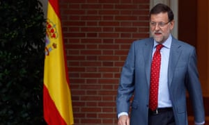 Spain's Prime Minister Rajoy leaves his office