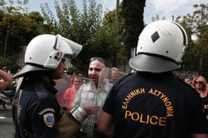 A school guard argues with the police during a protest outside the Administrative Reforms Ministry in Athens September 16, 2013. Greek police fired teargas to disperse school guards trying to enter the ministry in central Athens on Monday as teachers began a strike against public sector layoffs and forced transfers.
