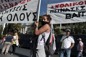 Greek school guards demonstrate outside the Ministry of Administrative Reform in Athens against their mandatory suspensions on September 16, 2013.