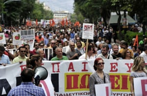 Greek school teachers march in central Athens during a demonstration on September 16, 2013.