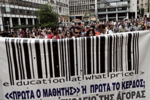 Greek teachers hold a banner during a protest in Athens on September 16, 2013.