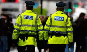Police officers on patrol in high-vis jackets