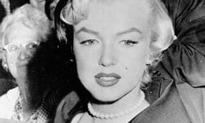 Marilyn Monroe wears the pearl necklace given to her by Joe DiMaggio.