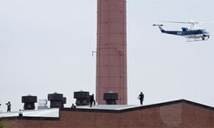 Police walk on the roof of Navy Yard