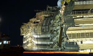 The side of the Costa Concordia that has been under water for nearly two years is revealed.