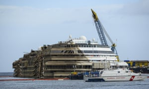 The Costa Concordia cruise ship upright in the water this morning near the harbour of Giglio, Italy. The salvage operation continued through the night.