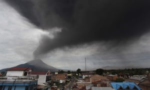 A cloud of ash rises from the crater of Mount Sinabung volcano during a fresh eruption, as seen from the Karo district on Indonesia's Sumatra island
