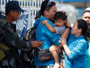 A two-year-old hostage is reunited with his parents. He was rescued near the site of renewed clashes between government troops and rebels in the residential village in Zamboanga city, southern Philippines