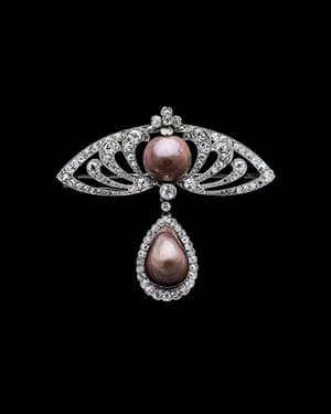 Pearls: Brooch, natural brown pearls set in platinum and diamonds