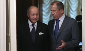 Russian foreign minister, Sergei Lavrov (right), talks to French foreign affairs minister, Laurent Fabius, in Moscow