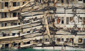 The severely damaged side of the stricken Costa Concordia is visible after the parbuckling operation succesfully righted the ship around 4am