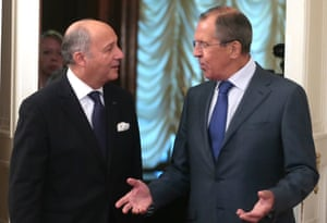 Russian Foreign Minister Sergei Lavrov talks with French Foreign Affairs Minister Laurent Fabius in Moscow.