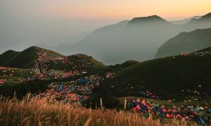 Tents are pitched during the 2013 International I Camping Festival on Mount Wugongshan, China. The event attracted more than 15,000 campers.