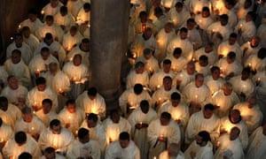 TOPSHOTS Roman Catholic clergymen hold c