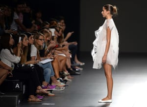 A model presents a creation by Ying Gao, during the 2014 Spring-Summer Mercedes-Benz Fashion Week in Madrid.