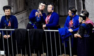 Women in traditional costume from the village of Spakenburg wait for the Golden Carriage in front of the Ridderzaal in The Hague, The Netherlands