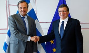 Greece's Prime Minister Antonis Samaras (L) is welcomed by European Commission President Jose Manuel Barroso (R) before their meeting at the EU Commission headquarters in Brussels September 17, 2013.