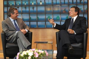 European Commission President Jose Manuel Barroso, right, talks to Greek Prime Minister Antonis Samaras at the European Commission headquarters in Brussels, Tuesday, Sept. 17, 2013.