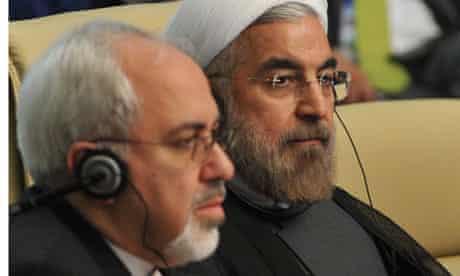 Iranian president Hassan Rouhani (R)