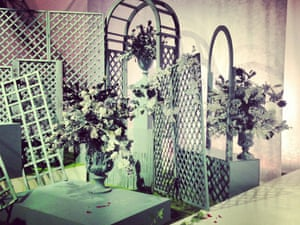 """""""I LOVE a Meadham Kirchhoff set, this one has urns and trellis and the catwalk is strewn with red and white roses. Set design by Phillip Wiegard - Helen Seamons""""  LFWplog"""