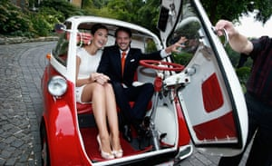 Prince Felix of Luxembourg and Princess Claire of Luxembourg depart in a Isetta bubble car after their civil wedding ceremony in Konigstein, Germany.