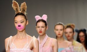 Models on the catwalk during the Ryan Lo show (Fashion East) during London Fashion Week SS14 at the TopShop Show Space. Another set of ears, anyone?
