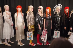 Models line up backstage before appearing on the catwalk for the Meadham Kirchhoff show at the Topshop Space in Regents Park