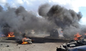 Thick smoke rises from burning vehicles at the site of a car explosion on the Syrian border crossing of Bab al-Hawa, at the Syrian-Turkish border which is manned by Free Syrian Army members, in Harem, Idlib.