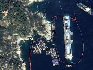 This satellite photo shows the upright Costa Concordia off Giglio Island, Italy, today. Engineers have declared the operation a success.