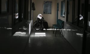 A patient sits in a wheelchair at the dialysis department of the al-Shifa hospital in Gaza City.