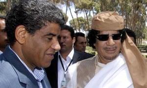 Abdullah al-Senussi with Muammar Gaddafi