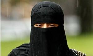 A woman wearing a full-face niqab veil.