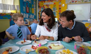 Nick Clegg and his wife, Miriam Gonzalez-Durantez, , speak to a pupil during a visit to Lairdsland Primary School in Kirkintilloch yesterday.