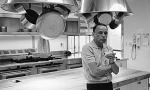 Entertainer Frank Sinatra eating a sandwich