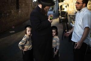 Sukkot preparations: A Jewish man inspects an etrog