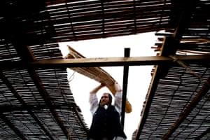 Sukkot preparations: Menachem Stolzberg constructis a sukkah at Satmar Yetev Lev Shul in Broughton