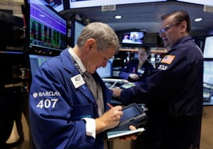 Trader Richard Newman, left, and specialist Peter King work on the floor of the New York Stock Exchange.