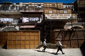 Sukkot preparations: Jewish children carry palms to be used as a roof for their sukkah