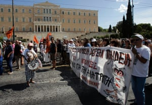 Protestors hold banners during a demonstration against austerity and job cuts on September 18, 2013 in Athens, Greece.