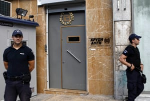 Police officers stand guard outside the headquarters of the Golden Dawn far-right party in Athens September 18, 2013.