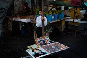 Sukkot: An ultra-Orthodox Jewish street vendor sells pictures of rabbis in Jerusalem