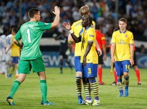 Arsenal_: Arsenal's Szczesny and Sagna celebrate