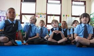 School children listen to teacher