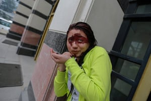 FTA: Jason Lee: A participant removes red paint from her face outside a theatre in Beijing