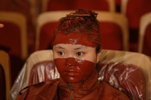 FTA: Jason Lee: A participant waits for the finishing touches to her makeup after she was p